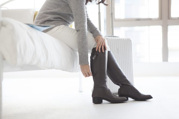Women are wearing boots in the hotel room