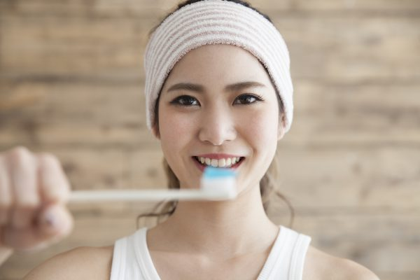 Young woman, toothbrush, toothpaste